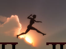 Woman jump through the gap. Symbol for success, freedom, happiness and self conficence Royalty Free Stock Images