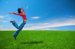 Woman jump in green field Stock Image