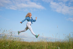 Woman jump in green grass field Stock Photo