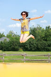 Woman jump. The woman is jumping from ground Stock Photos