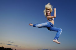 Woman jump at night Stock Image