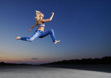 Woman jump at night Royalty Free Stock Photography
