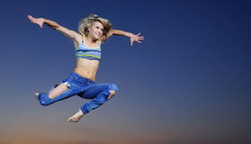 Woman jump at night Stock Images