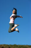 Woman jump outdoors Stock Photo