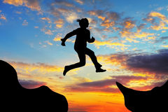 Woman jump over canyon stock images