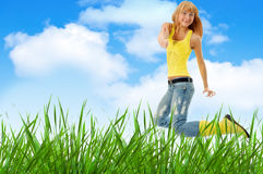 Woman jump over grass Royalty Free Stock Images