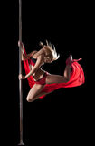 Woman jump during pole dance with fabric Stock Photography