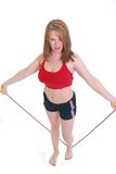 Woman jump roping Stock Photos