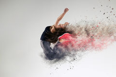 Woman in jump in studio Stock Image