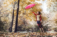 Woman jump with Umbrella Stock Photography