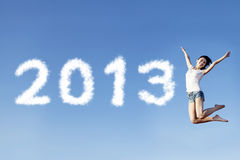 Woman jump welcoming new year 2013. A female jumping to welcome the new year of 2013 Stock Image