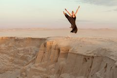 Woman jumped over the precipice in the dance. Stock Photo