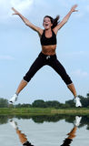 Woman jumping royalty free stock images