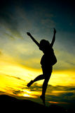 A woman jumping Royalty Free Stock Image