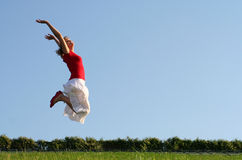 Woman jumping Stock Images