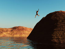 Woman jumping. A woman jumping from a cliff in to the water Stock Images