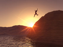 Woman jumping. A woman jumping from a cliff in to the water Stock Photo