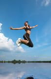 Woman jumping above water Royalty Free Stock Images