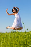 Woman jumping in the air Stock Images