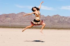 Woman jumping in the air Royalty Free Stock Photo