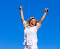 Woman jumping in the air Stock Photo