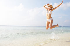 Woman Jumping In The Air On Tropical Beach Royalty Free Stock Photo