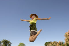 Woman Jumping With Arms Outstretched Royalty Free Stock Images