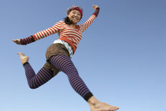Woman Jumping With Arms Outstretched Stock Photos