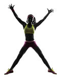 Woman jumping arms raised silhouette Stock Image