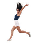 Woman jumping with arms up Stock Photos