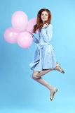 Woman is jumping with balloons royalty free stock photography