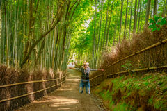 Woman jumping in Bamboo Forest Royalty Free Stock Photos