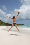 Woman jumping in the beach Stock Photo