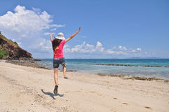 WOMAN JUMPING ON BEACH. Normal view of WOMAN JUMPING ON BEACH image Royalty Free Stock Photos