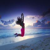 Woman jumping on beach Royalty Free Stock Photography