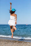 Woman jumping on a beach. Royalty Free Stock Photography