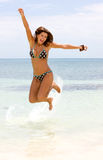 Woman jumping at the beach Royalty Free Stock Images