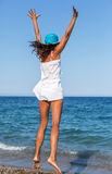Woman jumping on a beach. Stock Photo