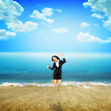 Woman Jumping On The Beach Royalty Free Stock Images