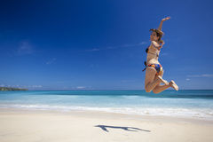 Woman jumping on the beach Stock Photography