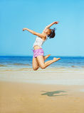 Woman jumping on the beach Royalty Free Stock Photo