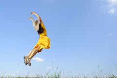 Woman Jumping with blue sky Royalty Free Stock Photos