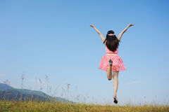 Woman Jumping with blue sky Royalty Free Stock Photo