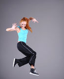 Woman jumping and dancing royalty free stock images