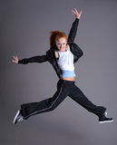 Woman jumping and dancing Stock Images