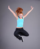 Woman jumping and dancing stock photo