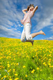 Woman jumping in field Royalty Free Stock Photos