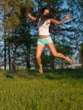 Woman jumping in field Stock Image