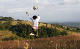 Woman jumping on field Stock Image