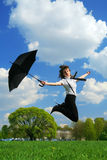 Woman jumping on the field stock photos